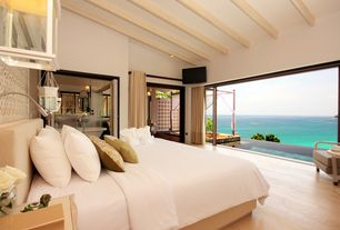 Contemporary Master Bedroom with Pendant light, Calligaris Swami Bed, Hardwood floors, Polywood Club Chair, Exposed beam