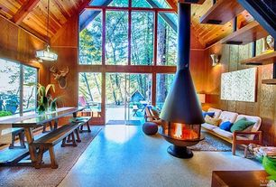 Rustic Living Room with simple granite tile floors, High ceiling, Transom window, Pendant light, Wall sconce