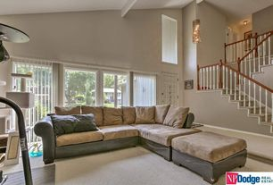 Traditional Living Room with specialty door, Exposed beam, Wall sconce, Balcony, Carpet