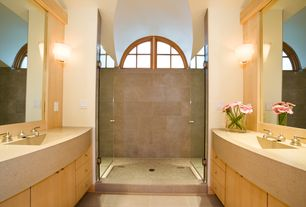 Contemporary Master Bathroom with Undermount sink, frameless showerdoor, Limestone counters, Wall sconce, Master bathroom