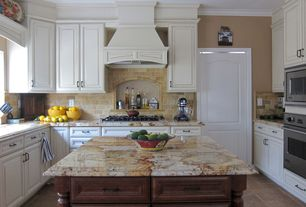 Traditional Kitchen with Kitchen island, Custom hood, U-shaped, Crown molding, Complex granite counters, Limestone Tile