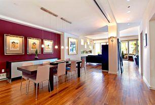 Modern Dining Room with Pendant light, Wall sconce, Hardwood floors