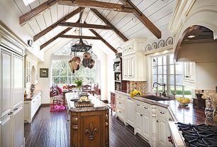 Cottage Kitchen with Paint 1, Dark hardwood floors, Casement, Framed Partial Panel, Complex granite counters, can lights