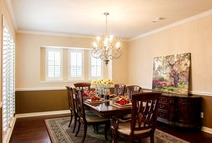 Traditional Dining Room with Chandelier, Hardwood floors, Chair rail, Crown molding