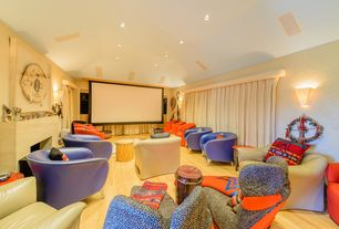 Contemporary Home Theater with Wall sconce, interior wallpaper, Hardwood floors, Built-in bookshelf, Cement fireplace