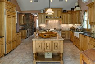 Country Kitchen with Soapstone counters, dishwasher, U-shaped, Custom hood, can lights, double oven range, Farmhouse sink
