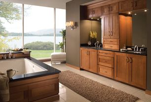 Craftsman Master Bathroom with Flat panel cabinets, Pental Black Galaxy Polished Granite, stone tile floors, specialty window