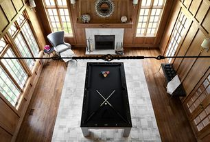 Contemporary Game Room with Built-in bookshelf, Crown molding, Carpet, double-hung window, Ceiling fan, Fireplace
