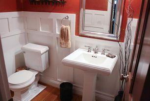 Traditional Powder Room with High ceiling, Uttermost stuart mirror, Hardwood floors, Pedestal sink, Wainscotting, Powder room