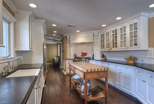 Traditional Kitchen with Farmhouse sink, Galley, American olean starting line white gloss ceramic wall tile, Crown molding