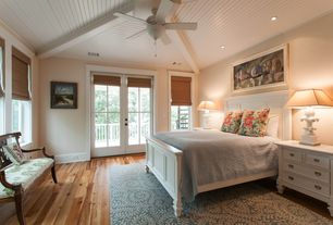 Cottage Guest Bedroom with Woven wood shade bamboo shade, French doors, Pottery barn coastal shutter bed, Crown molding