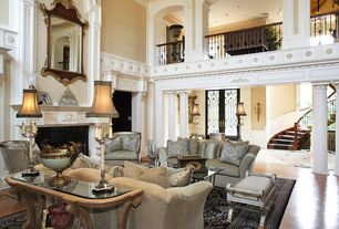Traditional Living Room with High ceiling, Crown molding, Wainscotting, Glass panel door, flush light, Cement fireplace