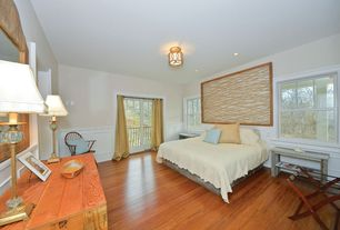 Cottage Master Bedroom with Chair rail, Standard height, Built-in bookshelf, flush light, double-hung window, Laminate floors