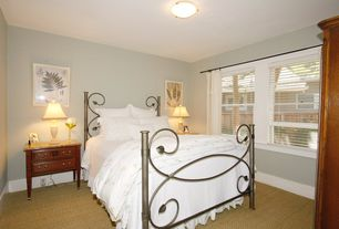 Cottage Guest Bedroom with Carpet