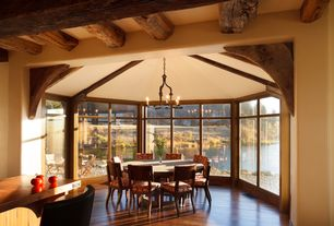 Rustic room with Hardwood floors, Wainscotting, Standard height, Chandelier, Exposed beam, picture window