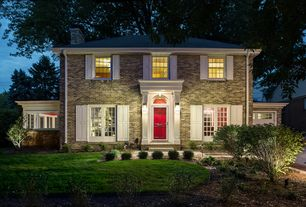 Traditional Exterior of Home with Transom window, flush light, Wall sconce, specialty door