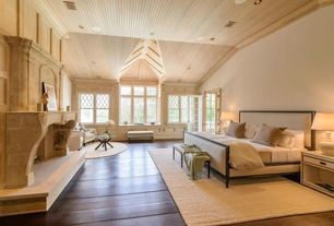 Traditional Master Bedroom with Moe's home collection - redondo coffee table, Bay window, French doors, Fireplace, can lights