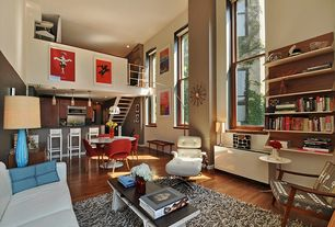 Contemporary Great Room with Hardwood floors, Built-in bookshelf, Pendant light, Loft, High ceiling