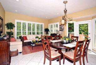 Tropical Living Room with Tanner rectangular coffee table, Paint1, limestone tile floors, paint2, Aaron upholstered chair