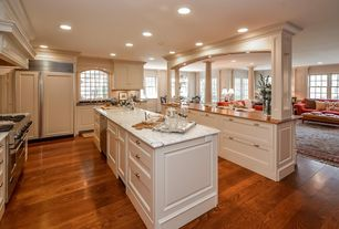 Traditional Kitchen with U-shaped, dishwasher, Casement, Crown molding, Wood counters, Arched window, double oven range