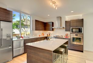 Contemporary Kitchen with Simple granite counters, Casement, L-shaped, can lights, flush light, built-in microwave, Wall Hood