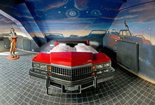 Eclectic Master Bedroom with Built-in bookshelf, Celestial spray paint art, Concrete tile , Standard height
