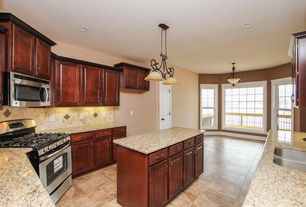 Craftsman Kitchen with flush light, specialty door, Kitchen island, Simple granite counters, U-shaped, Limestone Tile