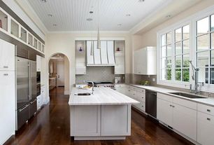 Contemporary Kitchen with Limestone Tile, Standard height, Paint 1, double wall oven, dishwasher, Flat panel cabinets