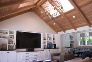 Craftsman Great Room with Casement, High ceiling, can lights, Built-in bookshelf, Skylight, Paint 1, Chandelier, Exposed beam