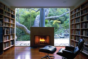 Contemporary Home Office with Standard height, Fireplace, Engineered hardwood flooring, Built-in bookshelf, can lights