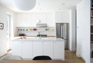 Modern Kitchen with Complex marble counters, European Cabinets, One-wall, Built In Refrigerator, Wood counters, gas range
