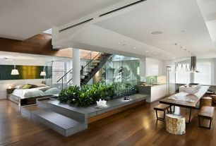 Contemporary Great Room with Hardwood floors, Pendant light, flush light, Standard height, double-hung window, can lights