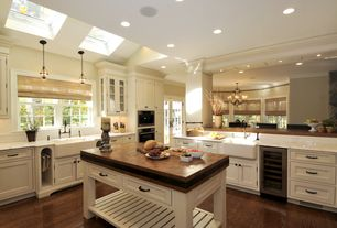 Traditional Kitchen with Pendant light, Framed Partial Panel, Complex marble counters, Wood counters, Breakfast bar, L-shaped