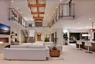 Contemporary Great Room with Built-in bookshelf, Pendant light, Standard height, brick fireplace, picture window, Columns