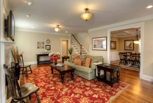Traditional Living Room with Standard height, Hardwood floors, specialty door, flush light, Crown molding, can lights