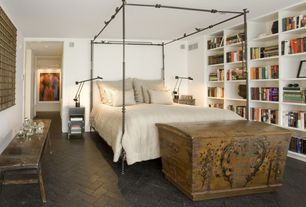 Eclectic Master Bedroom with Built-in bookshelf, herringbone tile floors
