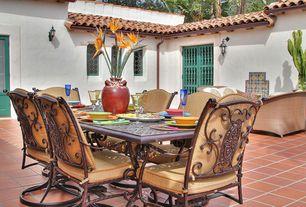 Mediterranean Patio with exterior tile floors, Glass panel door, exterior terracotta tile floors