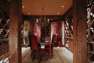 Traditional Wine Cellar with travertine floors, Crown molding, Chandelier
