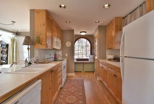 "Craftsman Kitchen with Flat panel cabinets, Galley, flush light, 4"" x 4"" glossy white tile, Window seat, Formica counters"