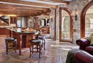 Rustic Kitchen with Glass panel, Limestone Tile, Wall sconce, Raised panel, Simple granite counters, herringbone tile floors