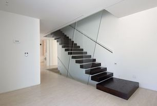 Modern Staircase with Floating staircase, Hardwood floors, High ceiling