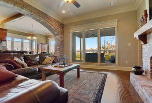 Traditional Living Room with interior brick, Crown molding, Lumber liquidators major brand engineered oak hardwood