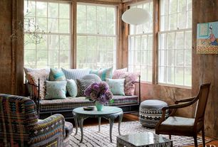 Eclectic Living Room with Embroidered Leather Pouf, Maison Suzanne Gallery Chair w/ Pakistani Quilt Upholstery, Pendant light
