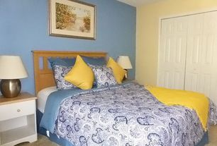 Traditional Guest Bedroom with Carpet, Nightstand, Hammered bronze table lamp