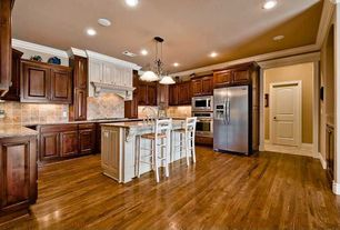 Traditional Kitchen with Kitchen island, Pendant light, Crown molding, Undermount sink, U-shaped, wall oven, electric cooktop