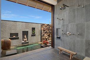 Tropical Master Bathroom with High ceiling, no showerdoor, Shower, Meta granite tile - dakota mahogany, Bathtub, Wall Tiles