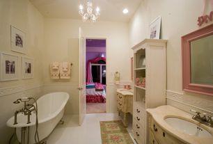 Traditional Kids Bathroom with Paint 2, Chandelier, Limestone counters, Undermount sink, can lights, Kids bathroom, Bathtub