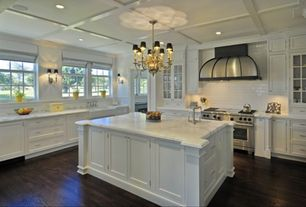 Traditional Kitchen with Flat panel cabinets, Wall sconce, Subway Tile, Box ceiling, Kitchen island, Farmhouse sink, L-shaped