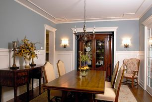 Traditional Dining Room with Chair rail, French doors, Built-in bookshelf, Crown molding, Wainscotting, Wall sconce