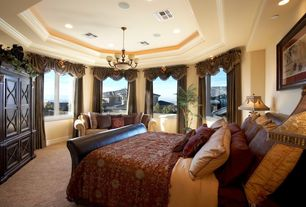 Traditional Guest Bedroom with Chandelier, Built-in bookshelf, Carpet, Wainscotting, Crown molding